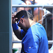 NEW YORK, NEW YORK - June 22: Christian Colon #24 of the Kansas City Royals leaves the dugout after being hit by a foul ball during the Kansas City Royals Vs New York Mets regular season MLB game at Citi Field on June 22, 2016 in New York City. (Photo by Tim Clayton/Corbis via Getty Images)