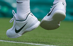LONDON, ENGLAND - Tuesday, June 21, 2011: The Nike tenns shoes of Roger Federer (SUI) depicting his six Wimbledon Singles' titles during the Gentlemen's Singles 1st Round match on day two of the Wimbledon Lawn Tennis Championships at the All England Lawn Tennis and Croquet Club. (Pic by David Rawcliffe/Propaganda)