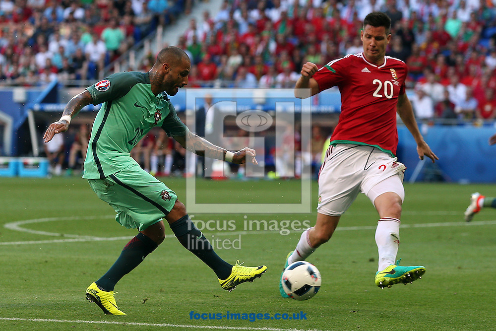Ricardo Quaresma of Portugal and Richard Guzmics of Hungary during the UEFA Euro 2016 match at Stade de Lyons, Lyons<br /> Picture by Paul Chesterton/Focus Images Ltd +44 7904 640267<br /> 22/06/2016