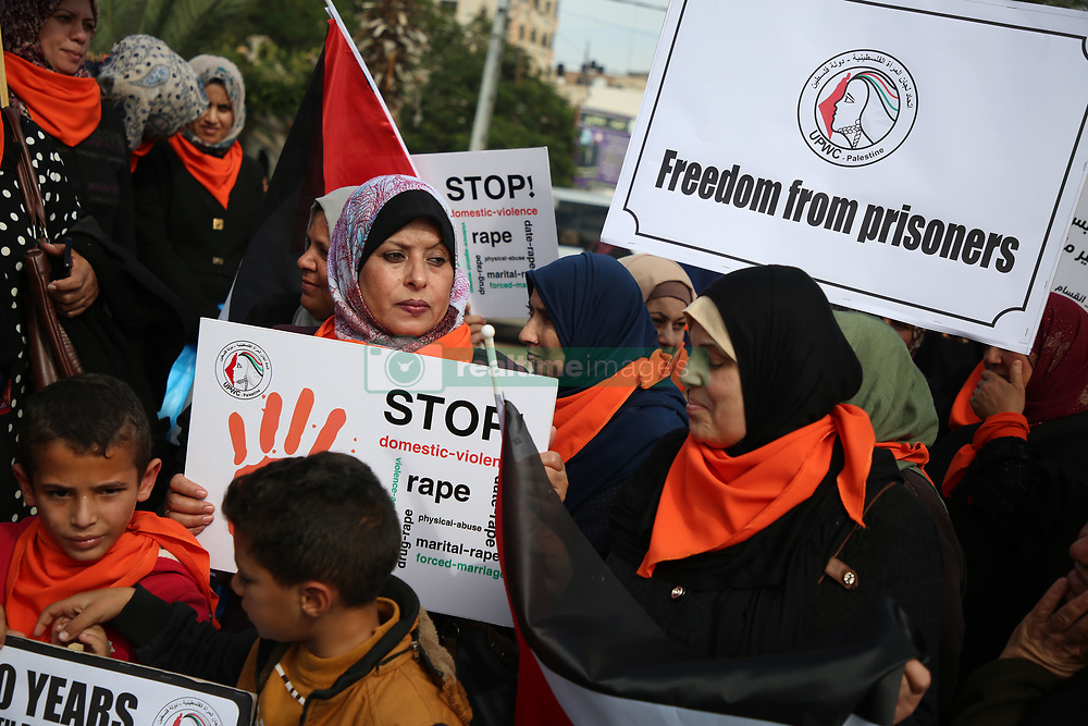 November 21, 2018 - Gaza, Palestine - Palestinian women hold placards and shout slogans during a rally to protest against the rising incidents of violence against women in Gaza City on November 21, 2018  (Credit Image: © Majdi Fathi/NurPhoto via ZUMA Press)