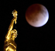 Above the Manitoba Legislative Building, a full moon becomes a blood moon as Canada experiences a full lunar eclipse, early Tuesday, April 15, 2014. (TREVOR HAGAN/WINNIPEG FREE PRESS)