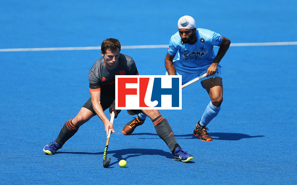LONDON, ENGLAND - JUNE 20:  Sander Baart of the Netherlands is watched by Talwinder Singh of India during the Pool B match between India and the Netherlands on day six of the Hero Hockey World League Semi-Final at Lee Valley Hockey and Tennis Centre on June 20, 2017 in London, England.  (Photo by Alex Morton/Getty Images)