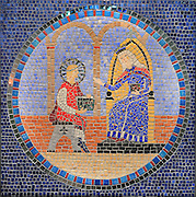 Mosaics panel based on the stainglass figurative stories achieved in 2012-2013 by the pupils of the school Notre Dame de Poissy under the direction of mosaics artist Sandrina Van Geel, Collegiale Notre-Dame de Poissy, showing the Western bell tower and chapels of the North aisle, a catholic parish church founded c. 1016 by Robert the Pious and rebuilt 1130-60 in late Romanesque and early Gothic styles, in Poissy, Yvelines, France. This panel depicts the education of Saint Louis by his mother Blanche of Castile. The Collegiate Church of Our Lady of Poissy was listed as a Historic Monument in 1840 and has been restored by Eugene Viollet-le-Duc. Picture by Manuel Cohen