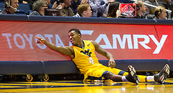 Jan 12, 2016; Morgantown, WV, USA; West Virginia Mountaineers guard Daxter Miles Jr. (4) celebrates at the scorers table during the first half against the Kansas Jayhawks at the WVU Coliseum. Mandatory Credit: Ben Queen-USA TODAY Sports