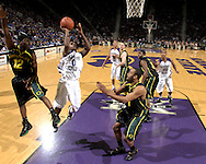 .Nov 29, 2007; Manhattan, KS, USA; Kansas State Wildcats guard Jacob Pullen (0) drives and scores between Oregon Ducks defenders Tajaun Porter (12) and Malik Hairston (1) in the first half at Bramlage Coliseum in Manhattan, KS. Oregon beat Kansas State in overtime 80-77. Mandatory Credit: Peter G. Aiken-US PRESSWIRE