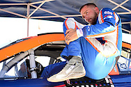 TUCSON, ARIZONA - MAY 07:  Ryan Partridge, driver of the #9 Sunrise Ford/Eibach Spring/Lucas Oil, climbs out of his car during practice for the NASCAR K&N Pro Series West NAPA Auto Parts Wildcat 150 at Tucson Speedway on May 7, 2016 in Tucson, Arizona.  (Photo by Jennifer Stewart/NASCAR via Getty Images)