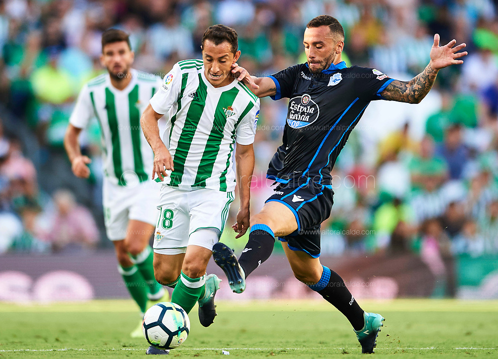SEVILLE, SPAIN - SEPTEMBER 16:  Andres Guardado of Real Betis Balompie (L) being followed by Guilherme dos Santos of RC Deportivo (R) during the La Liga match between Real Betis and Deportivo La Coruna  at Estadio Benito Villamarin on September 16, 2017 in Seville, .  (Photo by Aitor Alcalde Colomer/Getty Images)