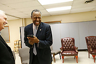 Republican presidential candidate Ben Carson laughs with staff member Mike Nason as he asks Siri questions Tuesday, Jan 26, 2016, before he heads into a worship service at Heritage Assembly of God in Des Moines.
