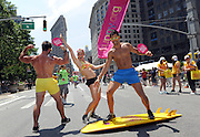 Pride marchers with the Greater Fort Lauderdale Convention & Visitors Bureau celebrate during the New York Gay Pride Parade, Sunday, June 29, 2014.   (Photo by Diane Bondareff/Invision for Greater Fort Lauderdale Convention & Visitors Bureau/AP Images)