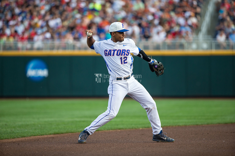 Richie Martin (12) of the Florida Gators throws during a game between the Miami Hurricanes and Florida Gators at TD Ameritrade Park on June 13, 2015 in Omaha, Nebraska. (Brace Hemmelgarn)