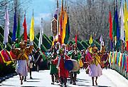 Musicians in festival procession at Tashichho Dzong, Thimpu, Bhutan