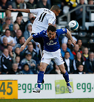 Photo: Steve Bond.<br /> Derby County v Everton. The FA Barclays Premiership. 28/10/2007. Craig fagan (L) rises above Leighton Baines (R)