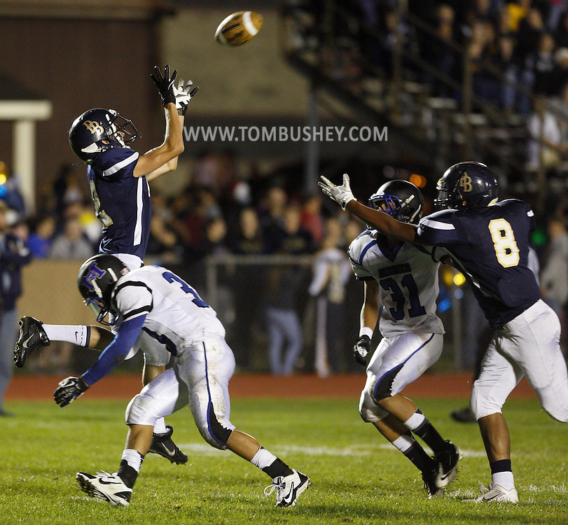 Pine Bush's Artie Econom, left, leaps to catch a touchdown pass as Middletown's Lex Galarza defends during a game in Pine Bush on Friday, Sept. 27, 2013. Pine Bush's Justin Speights (8) and Middletown's Isaiah Reyes (31) are at right.