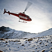 A helicopter lifts off after dropping a crew of geologists in southwest British Columbia