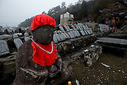 Rows of Ojizo-sama are lined up in preparation to reinstall them at a badly damaged temple in Ishinomaki, Miyagi Prefecture on March 1, 2012.