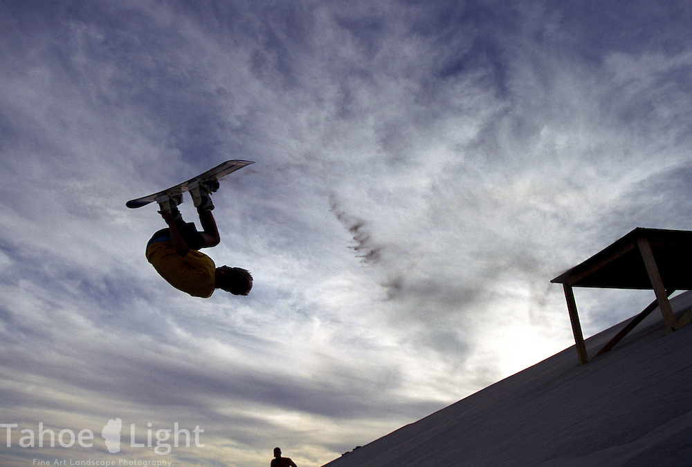 Sandboarder Alex King of Incline Village gets inverted of a ramp during the huckfest at Sand Mountain, Nevada.
