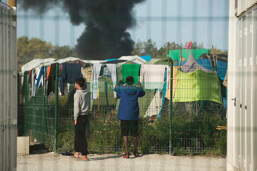 Refugee during the dismantlement of the notorious 'Jungle' camp in Calais the 25 october 2016 as part of operation planned to clear the camp, more than 7,000 refugees will be moved to evacuation centers across France. Calais, France, on October 25, 2016. Photo by Bakounine/ABACAPRESS.COM
