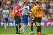 Newport County defender Regan Poole (26) pushes Tranmere Rovers midfielder James Norwood (10) away before Referee Ross Joyce gives Newport County defender Mark O'Brien (25) his second yellow card during the EFL Sky Bet League 2 Play Off Final match between Newport County and Tranmere Rovers at Wembley Stadium, London, England on 25 May 2019.