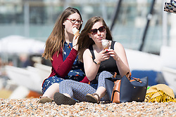 © Licensed to London News Pictures. 05/05/2018. Brighton, UK. Members of the public take to the beach in brighton on the May Bank Holliday weekend Saturday as sunny and warm weather is hitting the seaside resort. Photo credit: Hugo Michiels/LNP
