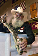 Donnie Willman, a Jaycee volunteer snake handler holds a western diamondback rattler during the 51st Annual Sweetwater Texas Rattlesnake Round-Up March 13, 2009 in Sweetwater, Texas. During the three-day event approximately 240,000 pounds of rattlesnake will be collected, milked and served to support charity.