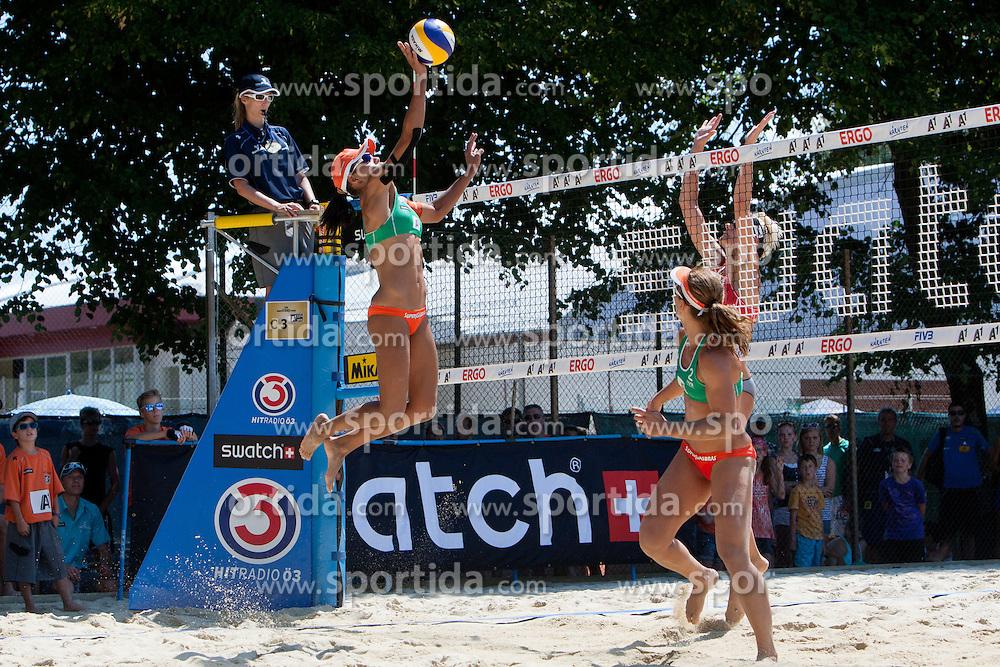 Juliana Felisberta Da Silva of Brazil vs Andreja Vodeb of Slovenia at A1 Beach Volleyball Grand Slam presented by ERGO tournament of Swatch FIVB World Tour 2012, on July 18, 2012 in Klagenfurt, Austria. (Photo by Matic Klansek Velej / Sportida)