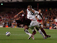 Photo: Henry Browne.<br /> Arsenal v FC Thun. UEFA Champions League.<br /> 14/09/2005.<br /> Jose Antonio Reyes of Arsenal is knocked down in the area by Jose Goncalves of Thun, but no penalty.