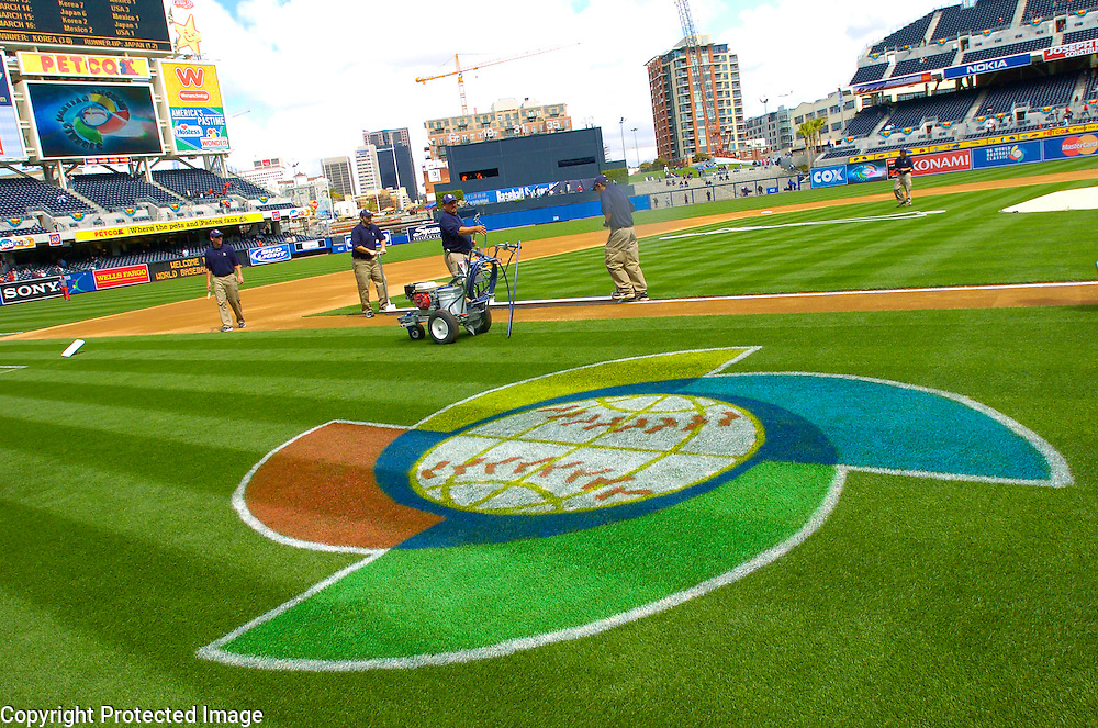 Field crew paints the lines before the start of the game against Team Dominican Republic and Team Cub in Semi-Final action of the World Baseball Classic at PETCO Park, San Diego, CA.