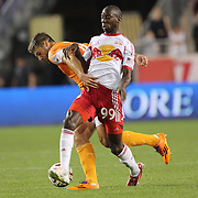 Bradley Wright-Phillips, (right),  New York Red Bulls, is tackled by David Horst, Houston Dynamo,  during the New York Red Bulls Vs Houston Dynamo, Major League Soccer regular season match at Red Bull Arena, Harrison, New Jersey. USA. 4th October 2014. Photo Tim Clayton