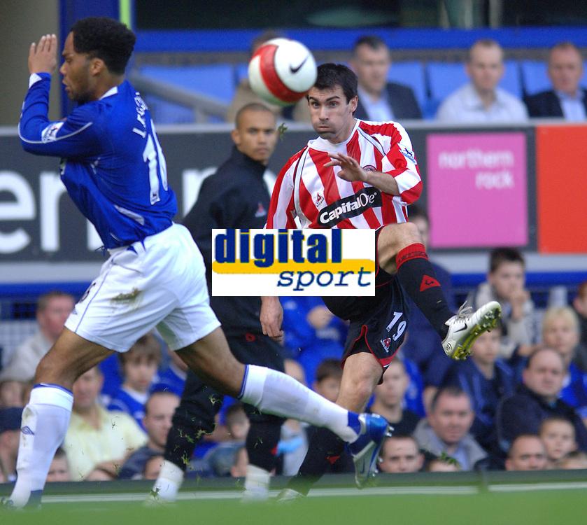 Photo: Paul Greenwood.<br />Everton v Sheffield United. The Barclays Premiership. 21/10/2006. Everton's Joleon Lescott, left, takes evasive action as Keith Gillespie shoots.