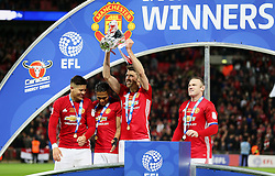 Michael Carrick of Manchester United celebrates with the EFL Trophy  - Mandatory by-line: Matt McNulty/JMP - 26/02/2017 - FOOTBALL - Wembley Stadium - London, England - Manchester United v Southampton - EFL Cup Final