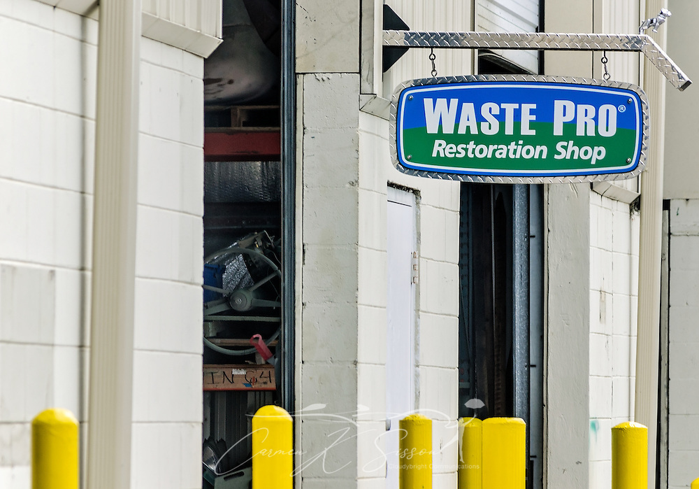 "The restoration shop is pictured at Waste Pro, March 18, 2016, in Sanford, Florida. The company has a garbage truck museum on the premises and restores antique garbage trucks. Waste Pro offers waste and recycling services to more than two million residential customers and more than 40,000 businesses in Alabama, Florida, Georgia, South and North Carolina, Louisiana, Mississippi, and Tennessee. The company has committed to ""going green"" by implementing a number of green initiatives, including using CNG (Clean Natural Gas) in its trucks, recycling more waste instead of sending it to landfills, and powering its regional headquarters throuh solar energy. (Photo by Carmen K. Sisson/Cloudybright)"