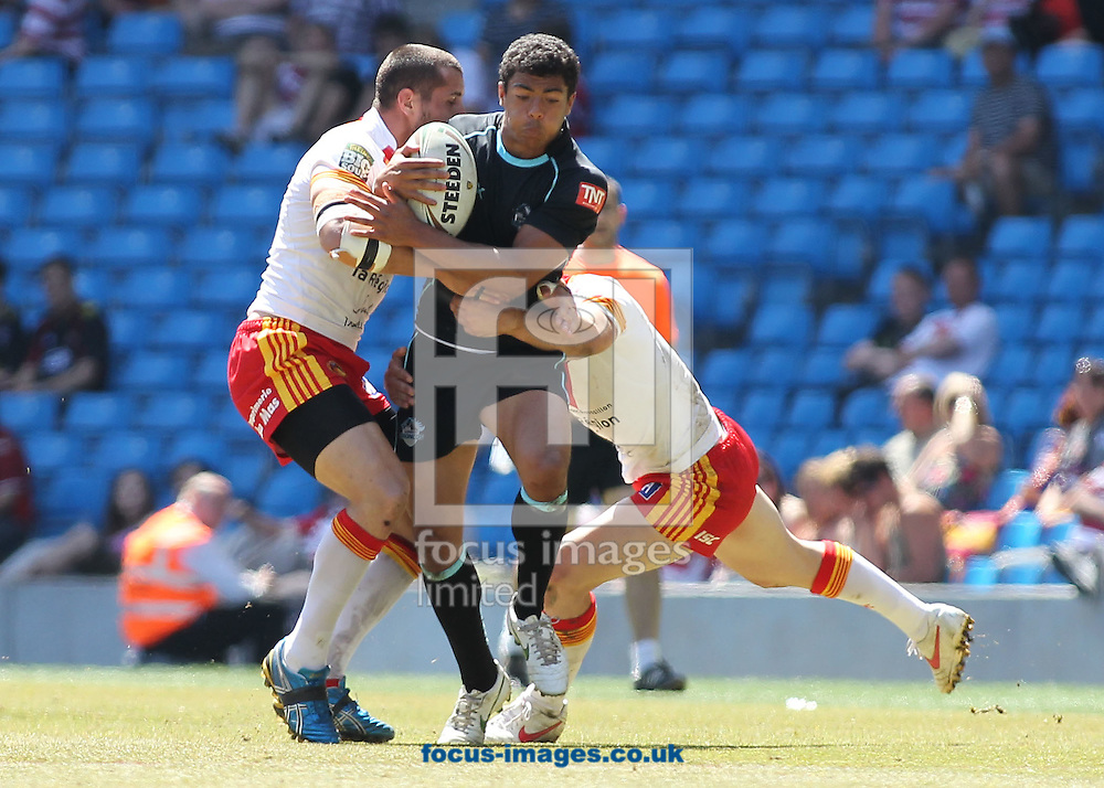 Picture by MIchael Sedgwick/Focus Images Ltd. 07900 363072.27/05/12.Kieran Dixon of the London Broncos attempts to break through the Catalan Dragons defence during the Stobart Super League 'Magic Weekend' match at the Etihad Stadium, Manchester.