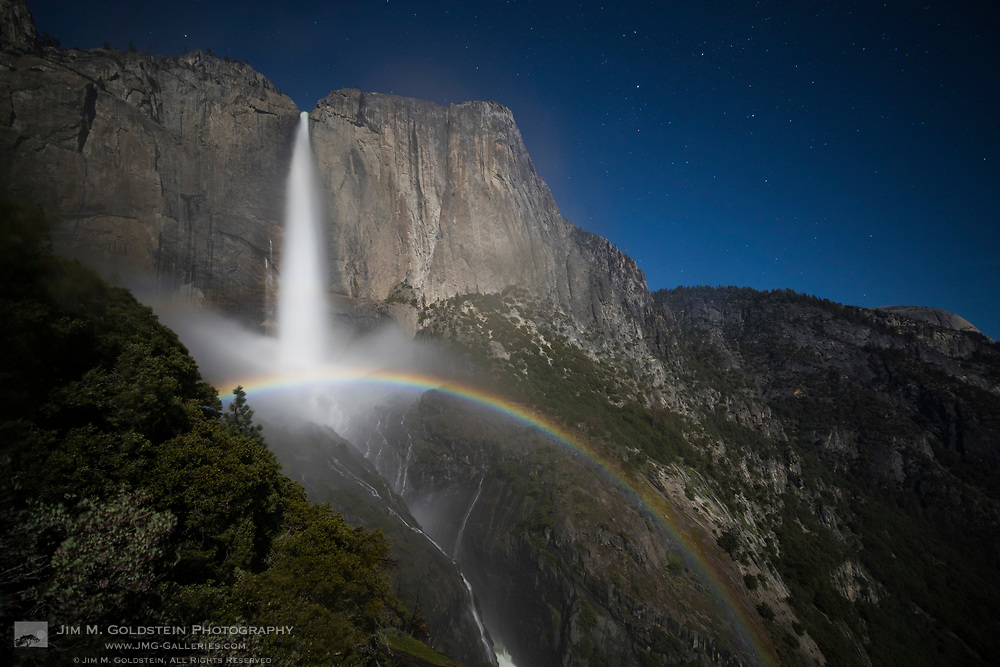 A large moonbow arcs across the mist from Upper Yosemite Falls, Yosemite National Park