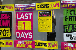 © Licensed to London News Pictures. 09/01/2020. London, UK. A staff member puts a display sign in the window of a branch of mother and baby retailer, Mothercare, in Wood Green, north London which is to close in one day. All 79 Mothercare stores are set to close by Sunday 12 January 2020 - putting 2,500 people out of work after the company went into administration last year. Photo credit: Dinendra Haria/LNP