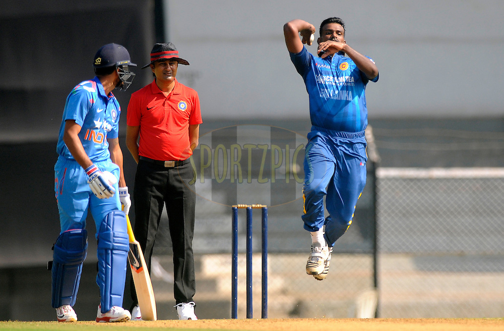 Lahiru Gamage of Sri Lanka bowls during the practice match between India A and Sri Lanka held at the CCI Stadium, Mumbai,  India on the 30th October 2014<br /> <br /> Photo by:  Pal Pillai/ Sportzpics/ BCCI