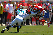 Kansas City Chiefs wide receiver Dexter McCluster (22) is tackled by Jacksonville Jaguars cornerback Dwayne Gratz (27) and free safety Dwight Lowery (25) during the Chiefs 28-2 win at EverBank Field on Sept. 8, 2013 in Jacksonville, Florida. The <br /> <br /> ©2013 Scott A. Miller