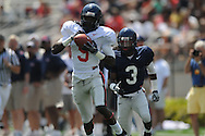 Red team receiver Melvin Harris (5) scores on a 61 yard pass play as Blue team defensive back Charles Sawyer (3) defends in Mississippi's Grove Bowl in Oxford, Miss. on Saturday, April 17, 2010.