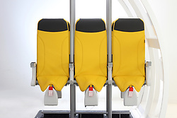 """The latest cost-saving solution to pack passengers into airline's cheap seats has been unveiled. Although the company producing them still call the draconian-looking devices 'seats' the near-standing slope could equally be termed air saddles. Unveiled this month at Hamburg's Airplane Interiors Expo the 'Skyrider 2.0' is designed by Italian aerospace interior design company Aviointeriors Group. And while it might sound like something from Star Wars the Skyrider 2.0 has much simpler appeal to budget operators as according to the company it allows 'an ultra-high density in the aircraft cabin.' An Aviointeriors Group spokesman said: """"Its main feature is the original bottom that ensures an increased upright passenger positon allowing installation of the seat at a reduced pitch, while maintaining an adequate comfort. """"The design of this seat enables to increase the passenger number by 20% allowing increasing profits for airline companies. Furthermore, Skyrider 2.0 weighs 50% less than standard economy class seats and the reduced number of components enable minimum maintenance costs. No company has yet announced plans to adopt the Skyrider 2.0 but there has been an air of resignation around the subject of standing seats since Ryanair first expressed interest in a more punishing version of the Skyrider eight years ago. Ryanair's plans for standing on it's budget flights were thwarted by regulators who scoffed at the idea of standing-room only in 2012 before trials were able to start. 26 Apr 2018 Pictured: Is this the awful future of flying?. Photo credit: EM / MEGA TheMegaAgency.com +1 888 505 6342"""