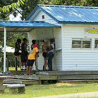 Customers line up to make their order at the Rockin' Robin Shaved Ice & Refreshment stand at Ballard Park on Labor Day in Tupelo.