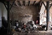 barn with various old stuff stacked in a heap