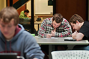 Travis Reed (left), Corey Brow (center), Alexander Reilly (right), and William Clark (far right) study in the atrium of the Academic and Research building located on Ohio University's West Green. The atrium is a gathering place for students, who often come to study, see friends or get a meal from the atrium coffee shop. Photo by Ross Brinkerhoff.