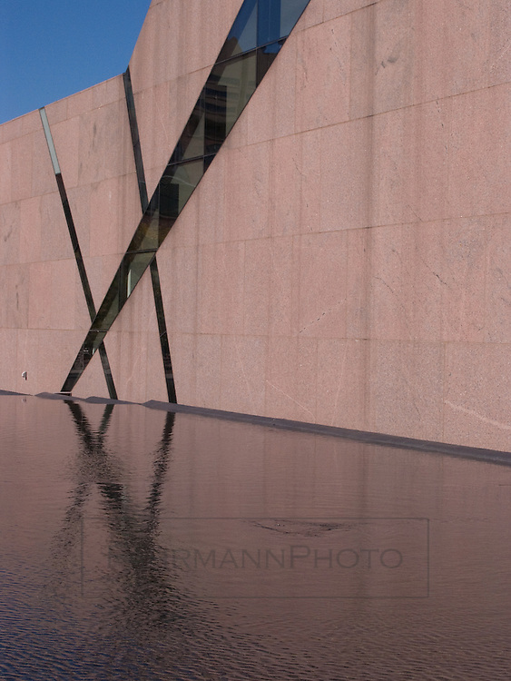 A tight composition of the reflecting pool and aspects of the building design