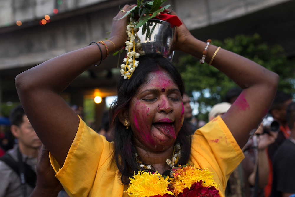 HIndu devotee in a trance during a Thaipusam festival in Kuala Lumpur, Malaysia, 03 Fenruary 2015.  Thousands of Hindus gather to participate in the annual Thaipusam festival dedicated to Lord Murugan. During Thaipusam day, devotees will fulfilled their vows by carrying 'kavadi (bearers had spikes pierced into their bodies) or pots of milk as offering to Lord Murugan. The devotees will make the arduous climbing up the 272 steps leading up to the temple cave and deposited at the feet of the deity to purify themselves.