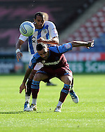 Picture by Graham Crowther/Focus Images Ltd. 07763140036.10/9/11 .Anton Robinson of Huddersfield tackles Joss Labadie of Tranmere during the Npower League 1 game at the Galpharm Stadium, Huddersfield.