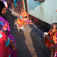 Neighbours gather in the small network of lanes that run through Horijon Polli. <br />