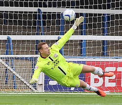 Milton Keynes Dons' David Martin cant keep out Peterborough United's Lee Tomlin's penalty - Photo mandatory by-line: Joe Dent/JMP - Tel: Mobile: 07966 386802 21/09/2013 - SPORT - FOOTBALL - London Road Stadium - Peterborough - Peterborough United V MK Dons - Sky Bet League 1