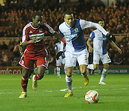 Picture by Paul Gaythorpe/Focus Images Ltd +447771 871632.26/12/2012.Marvin Emnes of Middlesbrough and Martin Olsson of Blackburn Rovers during the npower Championship match at the Riverside Stadium, Middlesbrough.