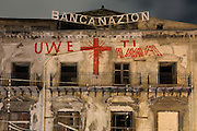 Ruined building of Banca Nazionale, Piazza Garraffello, Palermo, Sicily, Italy. The red letters UWE with the red cross correspond to Uwe Jaentsch, Austrian plastic artist who adopted the Garraffello square ten years ago. Picture by Manuel Cohen