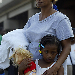 Amother and her child wait to be taken to safety out of the area during a helicopter pickup at the Causeway on Interstate 10 during the aftermath of Hurricane Katrina Friday, September 2, 2005 in New Orleans, Louisiana.  <br /> (Pasadena Star-News Keith Birmingham)
