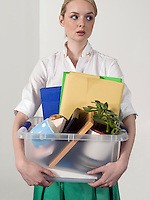 Office worker carrying personal belongings indoors